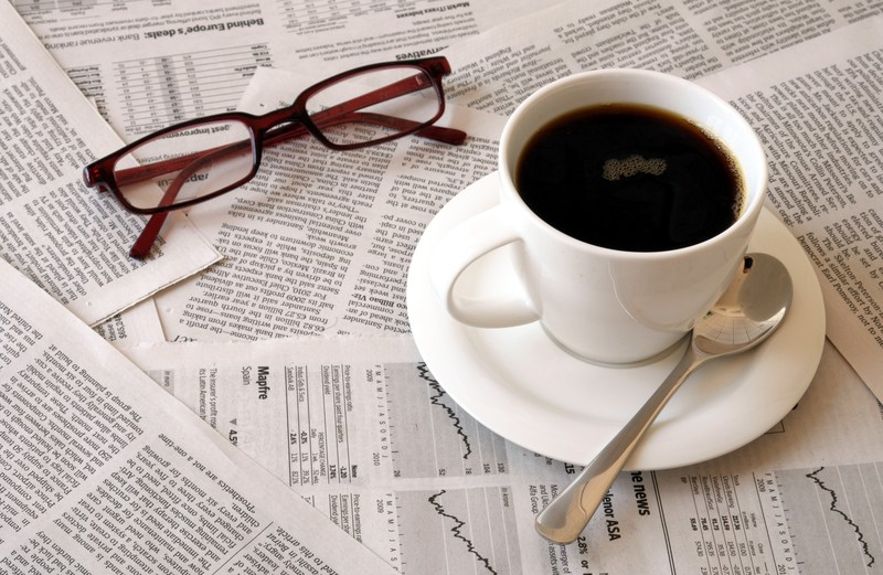Morning coffee glasses newspaper